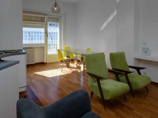 Casa Nina: allegra e spiritosa Sala da pranzo minimalista di Giulia Villani - Studio Guerra Minimalista