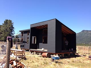 homify Wooden houses Wood Black