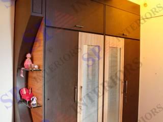 Shahil Jain Moderne Wohnzimmer von SP INTERIORS Modern