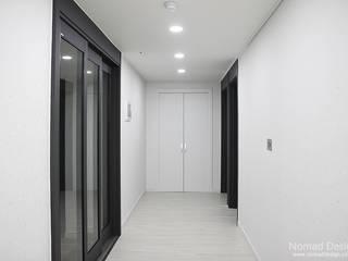 부산 서면 세종그랑시아 51평 아파트인테리어 - 노마드디자인: 노마드디자인 / Nomad design의  복도 & 현관