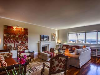 : Salas de estar ecléticas por Conceitos Itinerantes