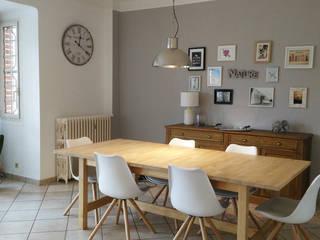 Salle à manger cosy:  de style  par Coralie Balléry Décoration