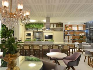 Projetando seu negocio: Espaços comerciais  por Dois A Arquitetura e Interiores LTDA