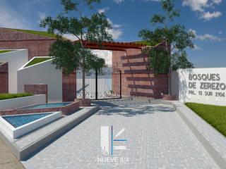 Acceso Fraccionamiento : Villas de estilo  por Nueve 3/4