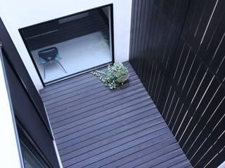 Jardines de estilo minimalista de 石川淳建築設計事務所 Minimalista