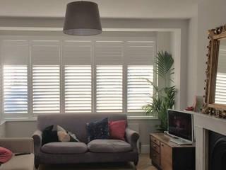 A Classic Finish for a Modern Living Room in Lewisham Plantation Shutters Ltd Ruang Keluarga Modern Kayu White