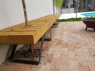 Tropical style gardens by Arquiteto Danilo Malvezzi Tropical