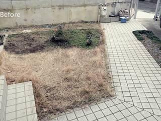レンガと枕木小路の庭: 株式会社グリーンテリアが手掛けたです。