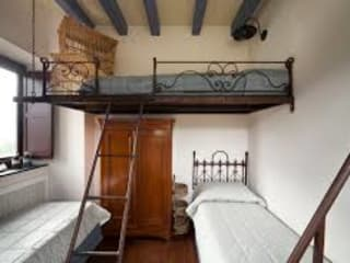 Camera da letto in stile  di Стальные конструкции