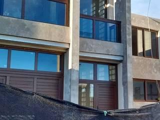 DUPLEX EN MIRAMAR: Casas unifamiliares de estilo  por ENTASIS ARQUITECTURA  -    DISEÑO  Y  CONSTRUCCIÓN