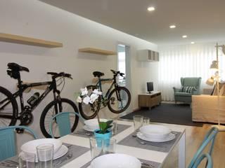 Passeio de bicicleta: Salas de estar  por Joana Neto | Interiores,Minimalista