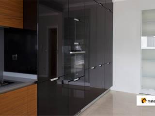 Cozinha em Cantanhede: Armários de cozinha  por Matobra, S.A.,Moderno