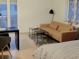 1-Zimmer-Appartement München:  Wohnzimmer von studio kristin engel