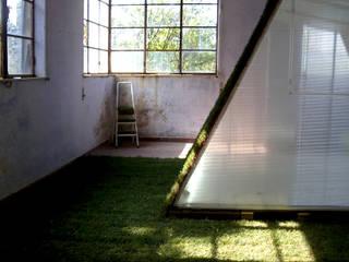 Lawn House:  in stile  di Altro_Studio