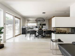 Widok na kuchnię: styl , w kategorii Salon zaprojektowany przez Ajot pracownia projektowa