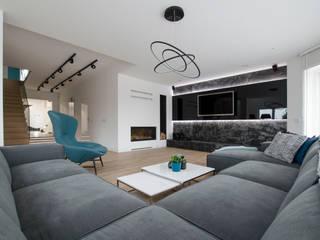 Projekt domu jednorodzinnego Nowoczesny salon od Ajot pracownia projektowa Nowoczesny