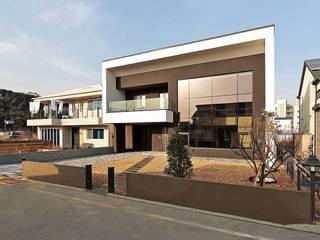 Casas  por 피앤이(P&E)건축사사무소 , Moderno