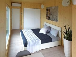 Nidoom - suite d'albergo prefabbricata e trasportabile: Hotel in stile  di Marlegno