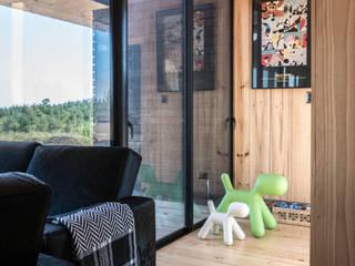 casa tunquen: Pasillos y hall de entrada de estilo  por GZ Fotografia