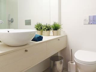Casa da Rute: Casas de banho  por Homestories