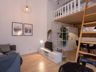 Moderno y actual loft en Barcelona:  de estilo  de Dekohuset