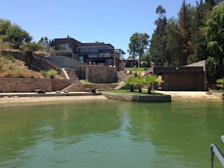 Casa EFZ orilla Lago Rapel, Condominio Costa del Sol II, La Estrella VI región.: Casas unifamiliares de estilo  por Sotomayor & Asociados