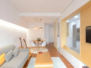 Piso Lola LIQE arquitectura Salones de estilo moderno
