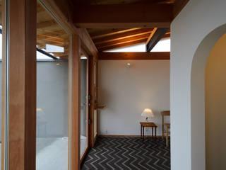 晴耕雨読: 風景のある家.LLCが手掛けた廊下 & 玄関です。