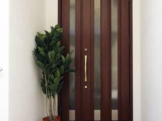 1F玄関: 株式会社青空設計が手掛けた廊下 & 玄関です。