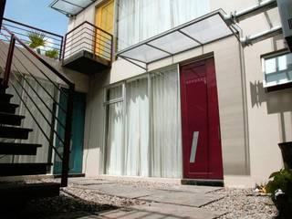 Condominio in stile  di RIVAL Arquitectos  S.A.S.