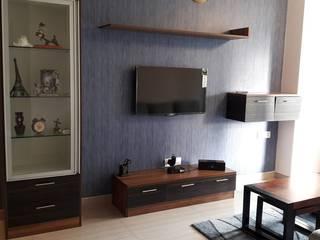 Ghatkopar residence:  Media room by Rennovate Home Solutions pvt ltd