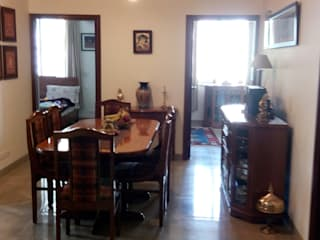 Old flat renovation:  Dining room by Rennovate Home Solutions pvt ltd