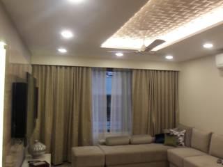 walkeshwar residence:  Living room by Rennovate Home Solutions pvt ltd