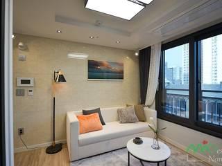 부산 분양 모델하우스 세팅, 북유럽 스타일 - 노마드디자인: 노마드디자인 / Nomad design의  거실