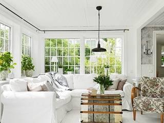 Ý tưởng thiết kế phòng khách màu trắng bởi Thương hiệu Nội Thất Hoàn Mỹ Hiện đại