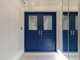 디자인스퀘어 Corredores, halls e escadas modernos Azul