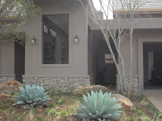 Structural Finishes to Meyersdal Eco Estate Villa CKW Lifestyle Associates PTY Ltd Eclectic style houses Grey