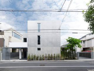柿の木坂の住宅: 有限会社コンパクツ一級建築士事務所が手掛けた二世帯住宅です。,