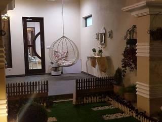 Pasillos, vestíbulos y escaleras de estilo moderno de Raheja Creations Moderno
