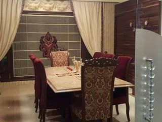 Comedores de estilo moderno de Raheja Creations Moderno