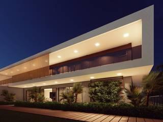 Fachada noturna da casa contemporânea : Casas pré-fabricadas  por Vortice Arquitetura