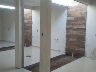 CLINICA DENTAL Paredes y pisos de estilo moderno de DALSE Construccion & Remodelación Moderno