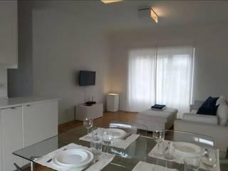 Remodelação - T1 Caxias - Sala de Jantar: Salas de jantar  por Casulo
