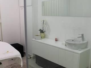 Sala de trabalho: Lojas e espaços comerciais  por OBRA ATELIER - Arquitetura & Interiores