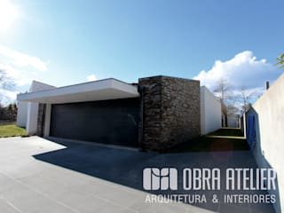 OBRA ATELIER - Arquitetura & Interiores Detached home Stone