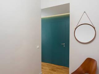CASA M+P. FIRENZE Ingresso, Corridoio & Scale in stile moderno di OKS ARCHITETTI Moderno