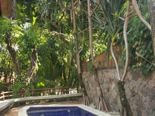 Casa de Praia Jardins tropicais por BSK Studio Tropical