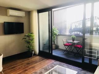 Live In Porto Apartamentos :   por Equevo - Interiores Design,Moderno