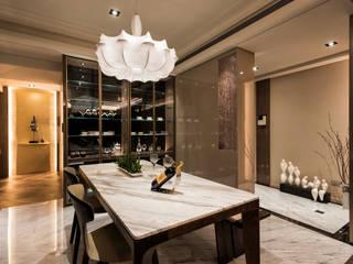 Modern dining room by 青易國際設計 Modern