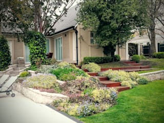 Un Jardín Clásico para una casa Clásica Vivero Antoniucci S.A. Jardines clásicos